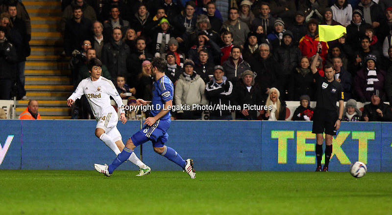 Wednesday 23 January 2013<br /> Pictured L-R: Ki SUng Yueng of Swansea is off side, he is against Cesar Azpilicueta of Chelsea <br /> Re: Capital One Cup semi-final second leg, Swansea City FC v Chelsea at the Liberty Stadium, south Wales.