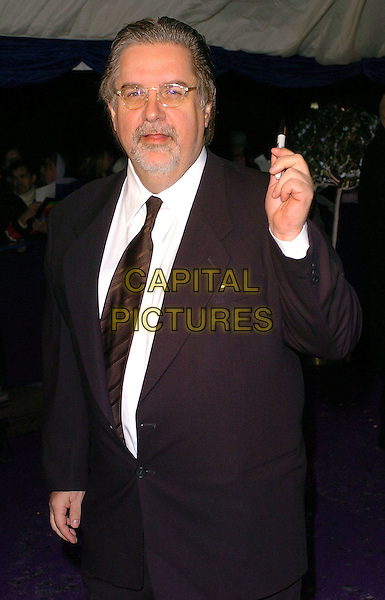 MATT GROENING.British Comedy Awards 2005 Arrivals, London..UK, United Kingdom..14th December 2005.Ref: CAN.half length black suit hand raised gesture glasses spectacles goatee beard facial hair.www.capitalpictures.com.sales@capitalpictures.com.©Capital Pictures