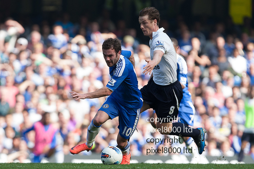 London, UK. Chelsea midfielder Juan Mata tussles with Tottenham captain Scott Parker during Barclays Premier League fixture Chelsea versus Tottenham Hotspur at Stamford Bridge 24 Mar.  Byline David Fearn Pixel 8000 Ltd