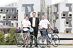 Two Scottish doctors cycle from Holyrood Parliament in Edinburgh bound for Westminster, London on a five day road trip to promote <br /> <br /> Pictured L-R: Dr Claire Gordon (Consultant in Acute Medicine - Lothian University Hospitals NHS Trust), Craig Stobo (High profile campaigner and who's wife died of sepsis), and Dr Dan Beckett (Consultant Acute Physician - NHS Forth Valley).<br /> <br /> Image by: Malcolm McCurrach