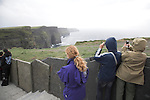 Tourists taking photos, Cliffs of Moher, Doolin, County Clare, Ireland