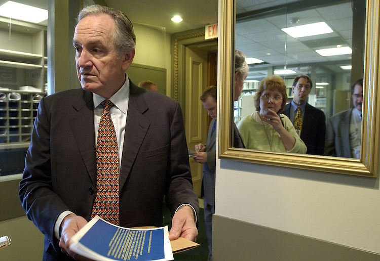 Tom Harkin, D-IA., talks with reporters before the press conference on an amendment to preserve overtime pay protections for millions of American workers.