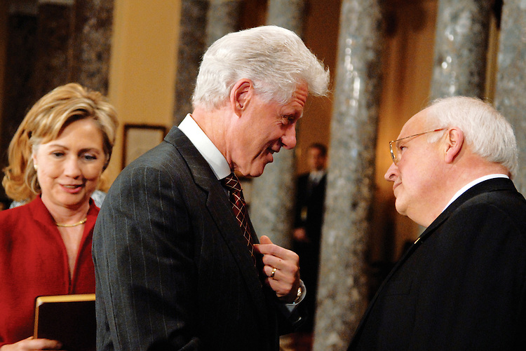 Former President Bill Clinton talks with Vice President Dick Cheney after the president's wife Sen. Hillary Clinton, D-N.Y., left, was sworn in to the 110th Congress at a mock swear-in ceremony in the Old Senate Chamber.
