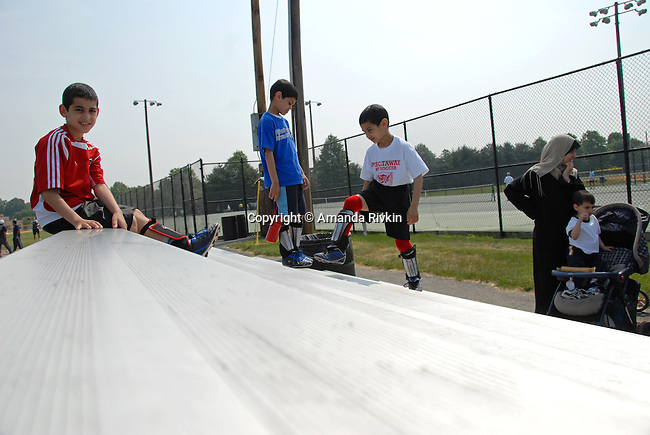 Palestinian immigrants Khalid Khalil, 9, Ahmed Khalil, 8, and Ibrahim Khalil, 6, at the Islamic Games with their mother and other siblings in South Brunswick, New Jersey on May 26, 2007.  All three boys were competing with the Piscataway Soccer Club in Piscataway, New Jersey.