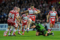 Ian Whitten of Exeter Chiefs skips over the tackle of Tom Francis of Exeter Chiefs during the European Rugby Challenge Cup semi final match between Gloucester Rugby and Exeter Chiefs at Kingsholm Stadium on Saturday 18th April 2015 (Photo by Rob Munro)