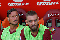 Calcio, Serie A: Roma vs Udinese. Roma, stadio Olimpico, 20 agosto 2016.<br /> Roma&rsquo;s Francesco Totti, left, and Daniele De Rossi sit on the bench during the Italian Serie A football match between Roma and Udinese at Rome's Olympic Stadium, 20 August 2016. Roma won 4-0.<br /> UPDATE IMAGES PRESS/Riccardo De Luca