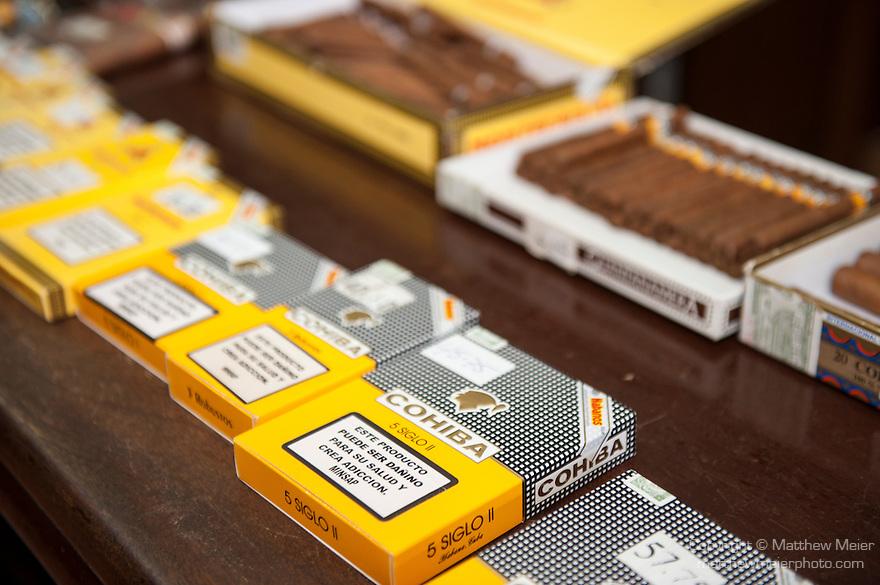 Havana, Cuba; Montecristo and Cohiba cigars on the counter of Ron's Tabaco Cafe in the Fortaleza de San Carlos de la Cabana