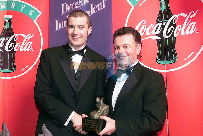 September sport star Keith Lynch accepts his prize from Kevin reynolds Drogheda Concentrates..Picture Fran Caffrey Newsfile.