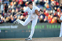 Pitcher Clarke Schmidt (6) of the South Carolina Gamecocks delivers a pitch in the Reedy River Rivalry game against the Clemson Tigers on Saturday, February 28, 2015, at Fluor Field at the West End in Greenville, South Carolina. South Carolina won, 4-1. (Tom Priddy/Four Seam Images)