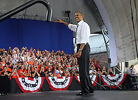 President Barack Obama waves to supporters during a campaign stop at the nTelos Wireless Pavilion in Charlottesville, VA.