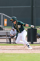 Oakland Athletics third baseman Max Schuemann (45) starts down the first base line during an exhibition game against Team Italy at Lew Wolff Training Complex on October 3, 2018 in Mesa, Arizona. (Zachary Lucy/Four Seam Images)