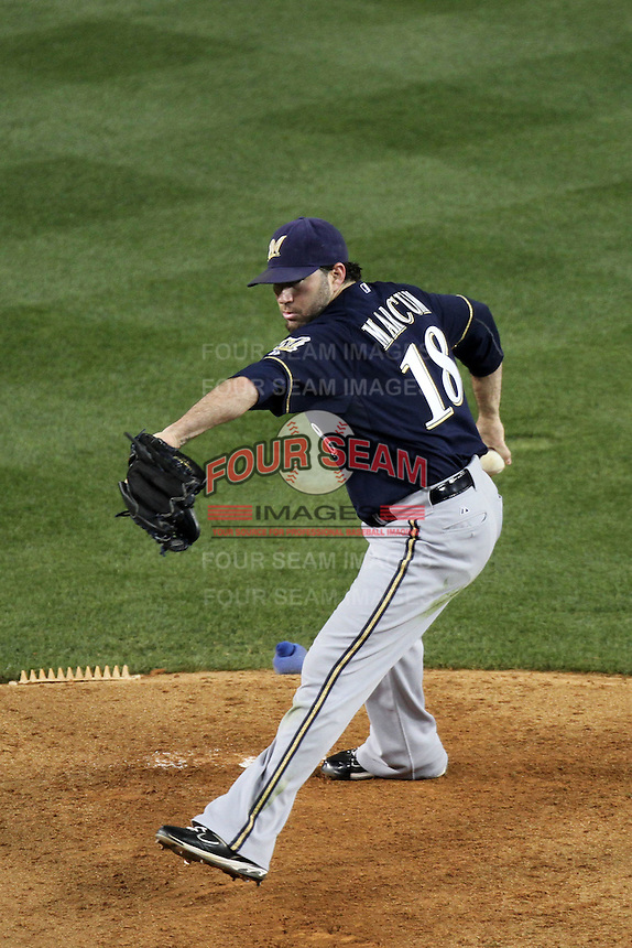 Shaun Marcum #18 of the Milwaukee Brewers pitches against the Los Angeles Dodgers at Dodger Stadium in Los Angeles,California on May 16, 2011. Photo by Larry Goren/Four Seam Images
