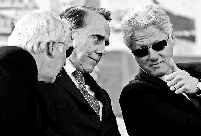 President Bill Clinton gives a thumbs up to Frederick Smith, Co-chairman of the National World War II Memorial Campaign, and Sen. Bob Dole, Chairman of the National World War II Memorial Campaign, during the groundbreaking ceremony for the World War II Memorial on the Mall in Washington, DC November 11, 2000.
