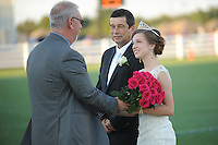 NWA Democrat-Gazette/ANDY SHUPE<br /> Emily Carpenter smiles Friday, Sept. 25, 2015, as she is crowned after she was selected as Har-Ber High School homecoming queen by Danny Brackett (left), principal of the school, as her father, Tim Carpenter, watches at Wildcat Stadium at Har-Ber High School in Springdale. Visit nwadg.com/photos to see more photographs from the ceremony.