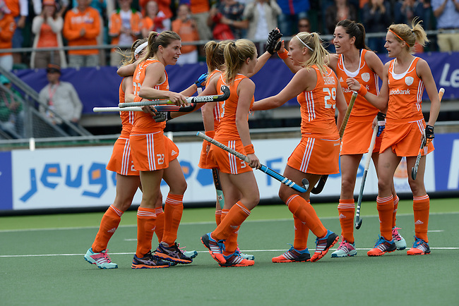 The Hague, Netherlands, June 14: Kim Lammers #23 of The Netherlands is congratulated by teammates after scoring a field goal to give The Netherlands a 2-0 lead during the field hockey gold medal match (Women) between Australia and The Netherlands on June 14, 2014 during the World Cup 2014 at Kyocera Stadium in The Hague, Netherlands. Final score 2-0 (2-0)  (Photo by Dirk Markgraf / www.265-images.com) *** Local caption ***