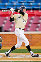 Charlie Morgan #26 of the Wake Forest Demon Deacons follows through on his swing against the Georgetown Hoyas at Wake Forest Baseball Park on February 26, 2012 in Winston-Salem, North Carolina.  The Demon Deacons defeated the Hoyas 5-2.  (Brian Westerholt / Four Seam Images)