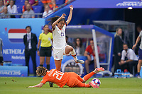 LYON, FRANCE - JULY 07: Christen Press #23, Dominique Bloodworth #20 during the 2019 FIFA Women's World Cup France final match between the Netherlands and the United States at Stade de Lyon on July 07, 2019 in Lyon, France.
