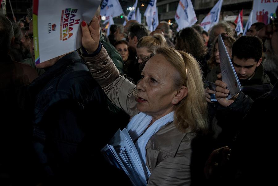 Athens, Greece, January 22, 2015. Syriza campaigner distributing programs during Alexis Tsipras' final rally.