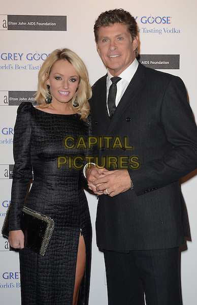 Hayley Roberts and David Hasselhoff .arriving at the Grey Goose Ball in aid of the Elton John Aids Foundation, Battersea Power Station, London, England, UK, 10th November 2012..half length long sleeve dress  black suit tie white shirt couple slit split clutch bag .CAP/WIZ.© Wizard/Capital Pictures.