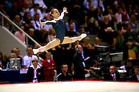 Oct 19, 2006; Aarhus, Denmark;  Dariya Zgoba performs straddle leap on floor exercise during women's All-Around final competition at 2006 World Championships Artistic Gymnastics.