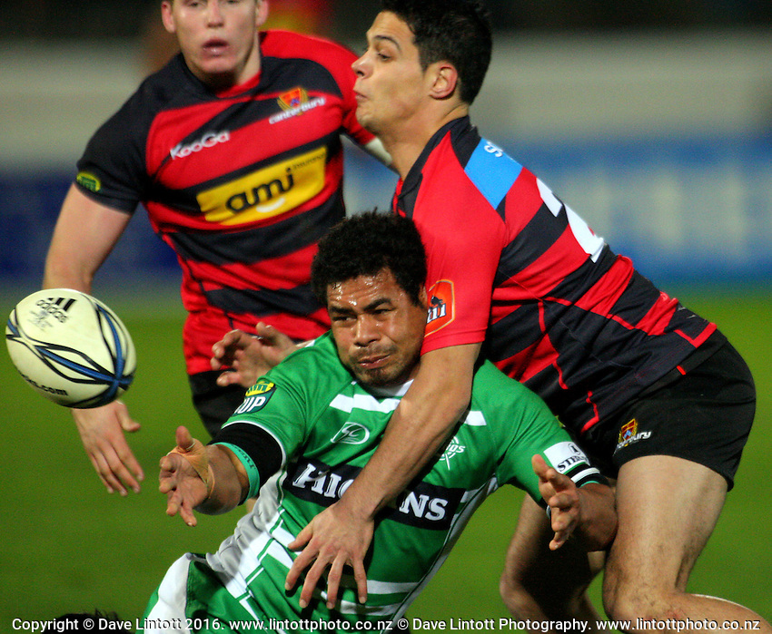 Manawatu's Tevita Taufui passes in the tackle. ITM Cup rugby - Manawatu Turbos v Canterbury at FMG Stadium, Palmerston North, New Zealand on Friday, 5 August 2010. Photo: Dave Lintott / lintottphoto.co.nz