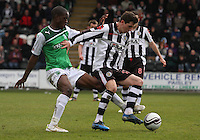 Kenny McLean being tackled by Isaiah Osbourne in the St Mirren v Hibernian Clydesdale Bank Scottish Premier League match played at St Mirren Park, Paisley on 29.4.12.