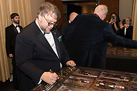 Oscar&reg; winner Guillermo del Toro signs a poster backstage with the Oscar&reg; for best motion picture of the year, for work on &ldquo;The Shape of Water&rdquo; during the live ABC Telecast of The 90th Oscars&reg; at the Dolby&reg; Theatre in Hollywood, CA on Sunday, March 4, 2018.<br /> *Editorial Use Only*<br /> CAP/PLF/AMPAS<br /> Supplied by Capital Pictures