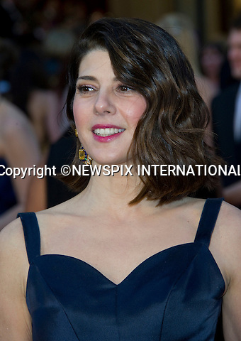 "MARISSA TOMEI.OSCARS 2011 RED CARPET ARRIVALS.The 83rd Academy Awards arrivals took place under a transparent  tent to keep the red carpet dry from the pending rain_ Kodak Theatre, Hollywood, Los Angeles_27/02/2011.Mandatory Photo Credit: ©Dias/Newspix International..**ALL FEES PAYABLE TO: ""NEWSPIX INTERNATIONAL""**..PHOTO CREDIT MANDATORY!!: NEWSPIX INTERNATIONAL(Failure to credit will incur a surcharge of 100% of reproduction fees)..IMMEDIATE CONFIRMATION OF USAGE REQUIRED:.Newspix International, 31 Chinnery Hill, Bishop's Stortford, ENGLAND CM23 3PS.Tel:+441279 324672  ; Fax: +441279656877.Mobile:  0777568 1153.e-mail: info@newspixinternational.co.uk"
