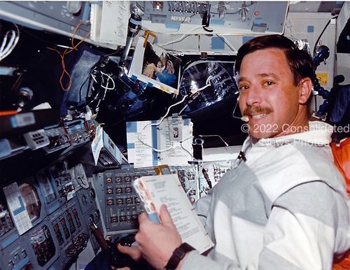 Astronaut Scott J. Horowitz mans the pilot's station of the Space Shuttle Discovery.  As well as serving as pilot for the National Aeronautics and Space Administration's (NASA) second mission to service the Hubble Space Telescope (HST), Horowitz was instrumental in the crafting of patch pieces to cover worn insulation on the giant telescope's surface.<br /> Credit: NASA via CNP