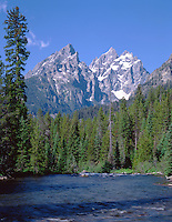 The Grand Teton cathedrals stand tall overlooking the Snake River
