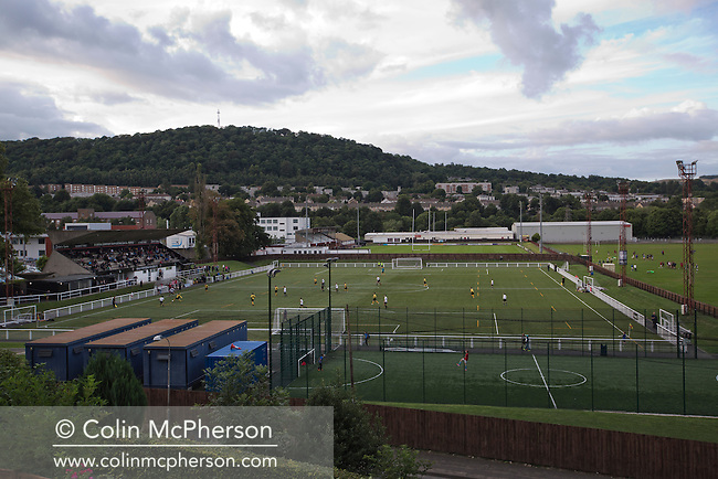 Gala Fairydean Rovers in action during their first home match in the Scottish Lowland Football League against Edinburgh City at Netherdale in Galashiels, with the Gala rugby ground in the background. Gala were formed in 2013 by an a re-amalgamation of Gala Fairydean and Gala Rovers, the two clubs having separated in 1908 and their ground in the Scottish Borders had one of only two stands designated as listed football stands in Scotland. The match ended in a 3-3 draw watched by 378 spectators.