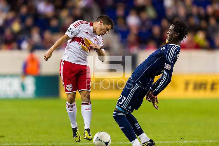 Kei Kamara (23) of Sporting Kansas City reacts as Connor Lade (16) of the New York Red Bulls misses a header. The New York Red Bulls and Sporting Kansas City played to a 0-0 tie during a Major League Soccer (MLS) match at Red Bull Arena in Harrison, NJ, on October 20, 2012.