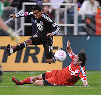 DC United midfielder Andy Najar (14) jumps to make a pass.  Toronto FC. defeated DC United 3-2 at RFK Stadium, October 23, 2010.
