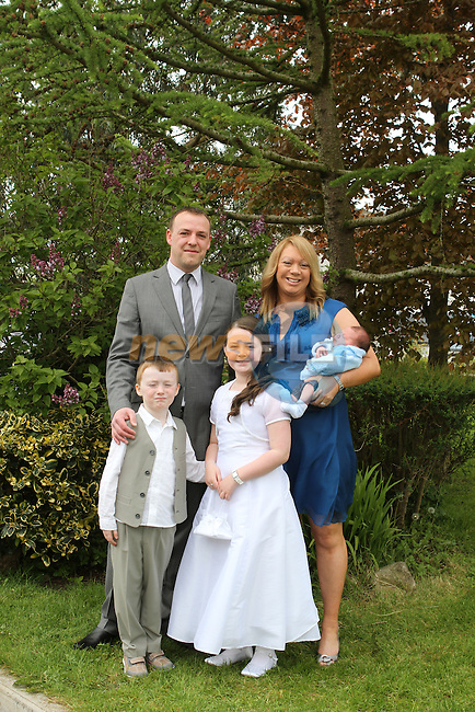 Emma clinton with her family at the Communion in Holy Family Church...(Photo Jenny Matthews/www.newsfile.ie)