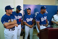 LOS ANGELES, CA - Jim Eisenreich, Charles Johnson, Gary Sheffield, and Bobby Bonilla of the Los Angeles Dodgers are interviewed by the media after coming to the team in a trade for Mike Piazza before a game at Dodger Stadium in Los Angeles, California in 1998. (Photo by Brad Mangin)