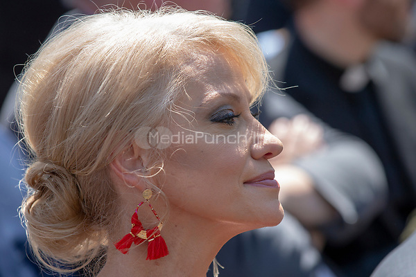 Counselor to the President Trump, Kellyanne Conway, listens as United States President Donald J. Trump speaks at a National Day of Prayer event in the Rose Garden at the White House in Washington, DC on May 3, 2018. Credit: Alex Edelman / CNP /MediaPunch