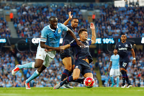 19.09.2015. Manchester, England. Barclays Premier League. Manchester City versus West Ham. Yaya Toure of Manchester City battles for the ball in the penalty area