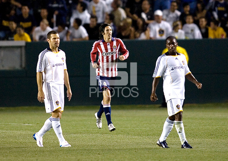 Chivas USA midfielder Sacha Kljestan (16) and LA Galaxy defender Greg Vanney (3) and teammate midfielder Mike Randolph (2) during the Super Clasico MLS match. The LA Galaxy defeated Chivas USA 5-2 during the SuperClasico at the Home Depot Center Stadium, in Carson, California, Saturday, April 26, 2008.