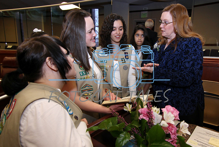 Nevada Assemblywoman Maggie Carlton, D-Las Vegas, talks with state Girl Scouts before the opening day of the 77th Legislative Session in Carson City, Nev. on Monday, Feb. 4, 2013. <br /> Photo by Cathleen Allison