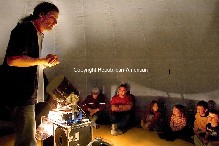 ROXBURY, CT- 14 APRIL 2007-041407JW10.jpg -- West Hartford The Childrens Museum Planetarium Director Jason Archer talks to children and their parentts inside a portable star lab planetarium at Minor Memorial Library in Roxbury Saturday afternoon.   Jonathan Wilcox Republican-American
