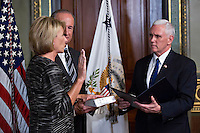 United States Vice President Mike Pence, right, swears in Betsy DeVos as U.S. secretary of education, with her husband Dick DeVos Jr. in the Vice President's Ceremonial Office in Washington, D.C., U.S., on Tuesday, Feb. 7, 2017. DeVos squeaked through a history-making Senate confirmation vote to become U.S. education secretary, as Vice President Mike Pence broke a 50-50 tie and Republicans staved off last-minute defections that would have killed her nomination. Photo Credit: Andrew Harrer/CNP/AdMedia