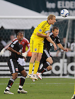 Columbus Crew forward Steven Lenhart (32) heads the ball against DC United midfielder Stephen King (20).  The Columbus Crew defeated DC united 1-0, at RFK Stadium, Saturday September 4, 2010.