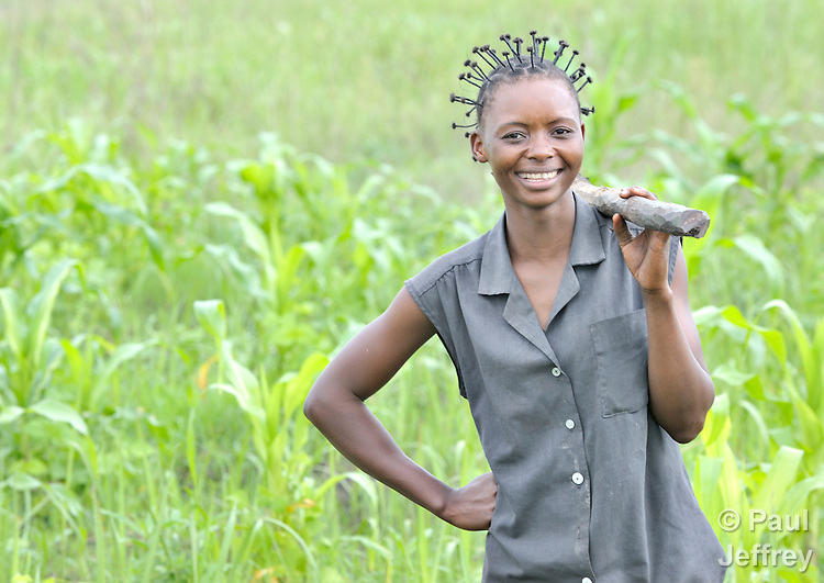 Ngoy Wa Ngoy Euphrasi, 17, pauses as she works in a field as part of a youth training program funded by United Methodist Women. The project is located in Kamina, in the Democratic Republic of the Congo, and mixes academic education and agricultural training.