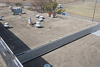 Roof Replacement and Mechanical Upgrades Stratford School For Aviation Maintenance Technicians.  Project No: BI-RT-860<br /> Contractor: Silktown Roofing, Manchester CT.<br /> James R Anderson Photography   New Haven CT   photog.com<br /> Date of Photograph: 13 April 2014<br /> Camera View: Northwest, Roof B & A  Image No. 15