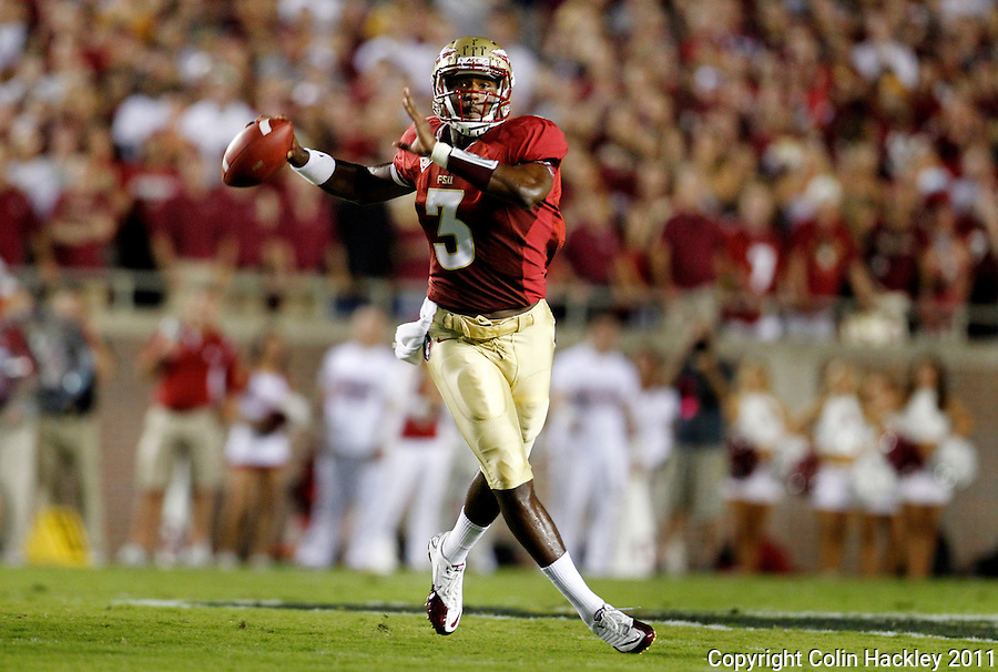 TALLAHASSEE, FL 9/17/11-FSU-OU091711 CH-Florida State's EJ Manuel looks for a receiver against Oklahoma during first half action Saturday at Doak Campbell Stadium in Tallahassee. .COLIN HACKLEY PHOTO