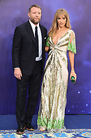 """Director, Guy Ritchie and wife Jaqui<br /> arriving for the """"Aladdin"""" premiere at the Odeon Luxe, Leicester Square, London<br /> <br /> ©Ash Knotek  D3500  09/05/2019"""