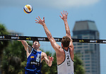 ST. PETERSBURG, FL - JUNE 18: Tri Bourne of the USA goes up for a spike during the FIVB Beach Volleyball World Tour St. Petersburg Grand Slam presented by the AVP on June 18, 2015 at Spa Beach in St. Petersburg, Florida. (Photo by Donald Miralle for the AVP)