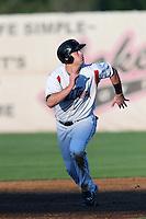 Jonathan Jones #23 of the Salem-Keizer Volcanoes run the bases during a game against the Spokane Indians at Volcanoes Stadium on July 26, 2014 in Keizer, Oregon. Spokane defeated Salem Keizer, 4-1. (Larry Goren/Four Seam Images)