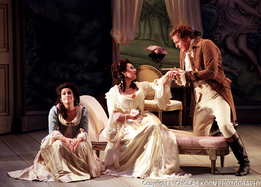 2000 - THE MARRIAGE OF FIGARO - The Counts (John Hancock) false pledge of love to his wife (Marie Plette) leaves susanna  (Christine Brandes) unimpressed in Opera Pacifics production of 'The Marriage of Figaro'.