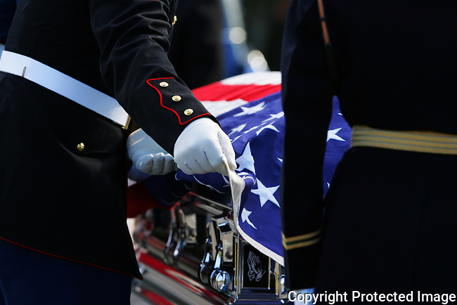 A military honor guard tends to the flag atop the casket during the funeral of former U.S. Senator Shirley Chisholm in Palm Coast, Fla., Saturday, Jan. 8, 2005.(Brian Myrick)
